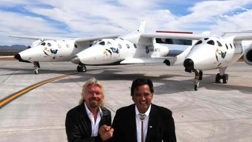 Virgin boss Richard Branson (L) and New Mexico Governor Bill Richardson (R) pose with the Virgin Galactic VSS Enterprise ...