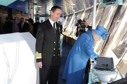 Queen Elizabeth II blows the ship's horn during the naming ceremony.
