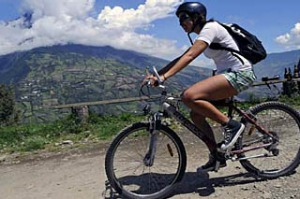 Forces of nature ... cycling while the Tungurahua volcano erupts.