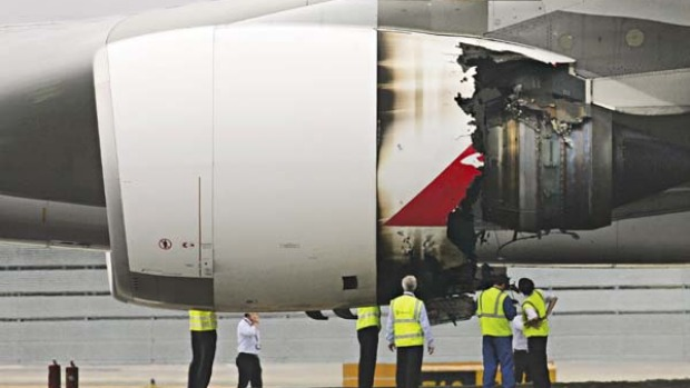 The damaged engine of the Qantas A380 passenger plane QF32 after it made an emergency landing at Changi airport on ...