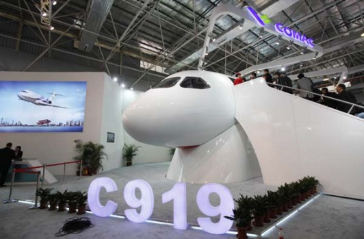 A scale model of Chinese-made C919 passenger airliner is displayed at the 8th China International Aviation and Aerospace ...