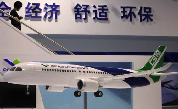 A visitor walks down from a mock-up of Chinese-made C919 passenger airliner at the 8th China International Aviation and ...