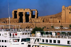 Age of contrasts ...  a cruise ship passes the ruins of Kom Ombo.