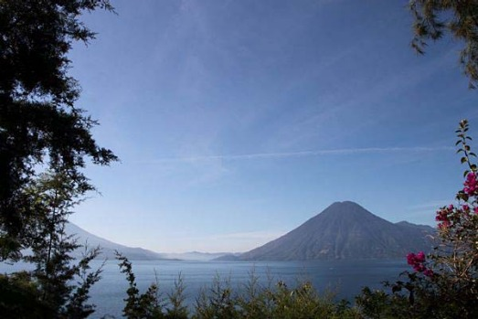 Staying at La Casa del Mundo, Guatemala. To the left, a towering volcano. To the right, two more. Down below, a huge ...