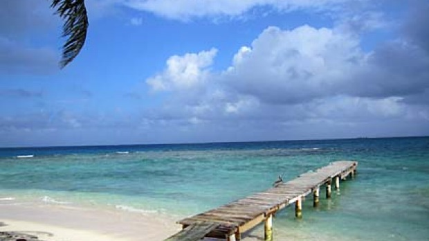 Sandy Cay, one of two unbelievably affordable private islands for rent off the coast of Utila, itself a tiny island ...