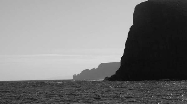 Approaching the ragged dolerite battlements of Cape Raoul.