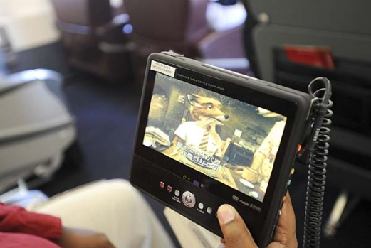 An individual DVD player sits aboard a Delta Air Lines charter Airbus A319.