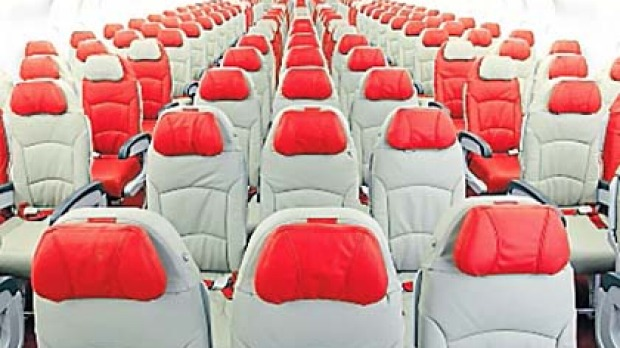 AirAsia X economy class ... those with bigger builds are advised to book exit-row seats.
