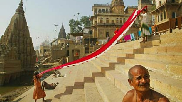 Laundry day ... women prepare to dry their saris on the ghats of the Ganges.