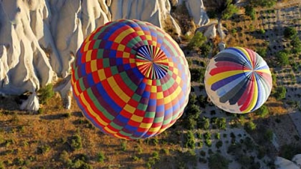 Rise and shine ... inflating balloons at sunrise.