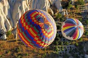 Rise and shine ... inflating balloons at sunrise Cappadocia Turkey