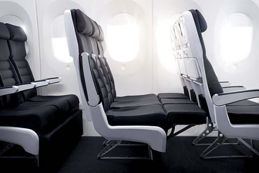 The Skycouch footrests lock into position to create a flat surface passengers can stretch out on.