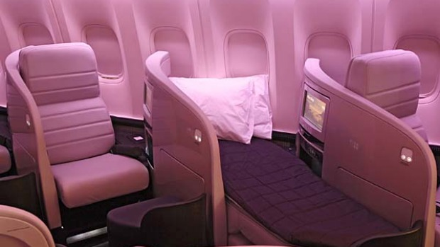 Air New Zealand's business premier class seats fold over to create a long flatbed.
