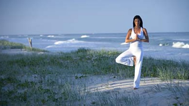 Poise ... sand-in-the-toes yoga.