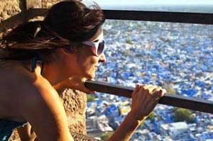 Woman overlooking Jodhpur from Meherangarh Fort.  India