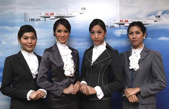 Transsexual flight attendants hired by new Thai airline PC Air make their public debut.