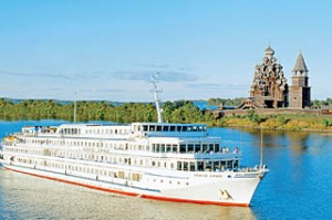 Old Russia ... (from left) the Viking Surkov passes the wooden buildings of Kizhi Island