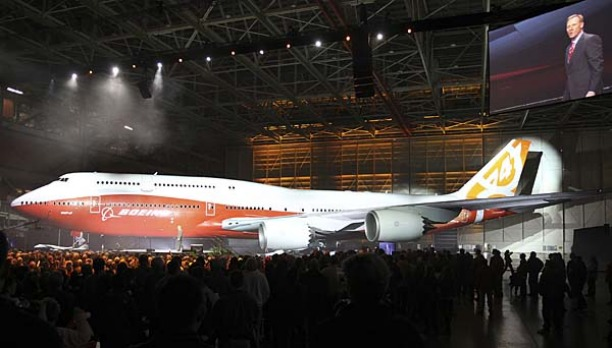 Boeing raises a curtain to unveil the 747-8 jumbo passenger jet to thousands of employees and guests at the company's ...