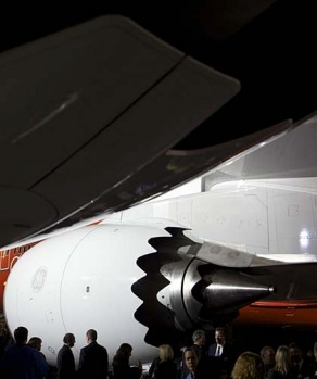 A crowd of attendees examines a Boeing 747-8 Intercontinental, the company's newest and largest passenger plane.