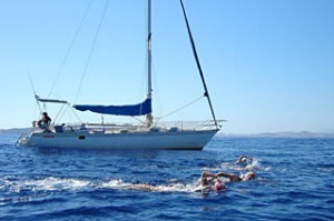 In the deep end ... (from far left) the swimmers bob in the Aegean Sea; the group swims beside the yacht Katerina