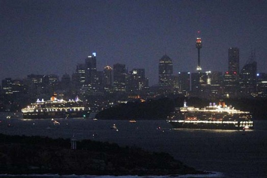 Cruise liners Queen Mary 2 and Queen Elizabeth travel through Sydney Harbour together.