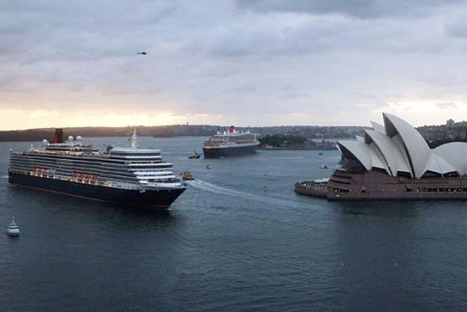 Cruise liners Queen Mary 2, centre, and Queen Elizabeth  are seen next to the Sydney Opera House.
