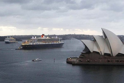 Cruise liners Queen Mary 2, right, and Queen Elizabeth move past Sydney Opera House.