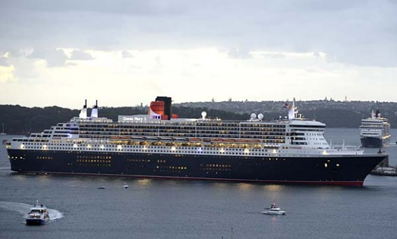The Queen Mary 2, front,  leads the Queen Elizabeth into Sydney Harbour.