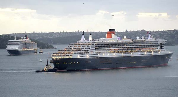 The Queen Mary 2, right,  leads the Queen Elizabeth into Sydney Harbour.