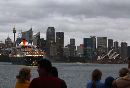 People watch as The Queen Mary 2 enters Sydney Harbour.
