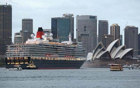 The Queen Elizabeth cruises past the Sydney Opera House this morning.