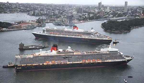 The Queen Elizabeth (front) and Queen Mary 2 (rear) arrive in Sydney.