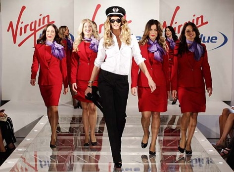 Elle Macpherson and Virgin Blue staff showcase their new uniforms.