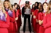 Elle Macpherson and Virgin Blue staff showcase the new uniforms at the launch.
