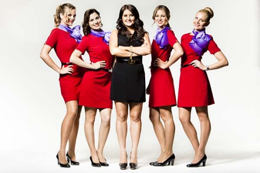 The new uniform for Virgin Blue cabin crew and ground staff were designed by Project Runway winner Juli Grbac.