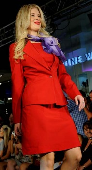 An airline crew member walks down the catwalk during the fashion launch of Virgin Blue's new uniform in Sydney.