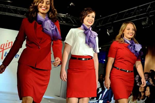 Airline crew members walk down the catwalk during the fashion launch of Virgin Blue's new uniform.