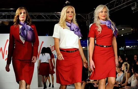 Airline crew members walk down the catwalk during the fashion launch of Virgin Blue's new uniform in Sydney.
