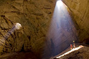 Ambient light streams through two fissures more than 100 metres above the cave floor into the Majlis Al Jinn, one of the ...
