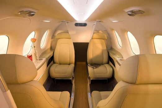 The Embraer Phenom 100's interior, which in this layout seats four passengers, has comfortable cream leather seats ...