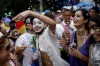 "People dance during the ""Carmelitas"" street carnival parade in Rio de Janeiro, Brazil, Friday, March 4."