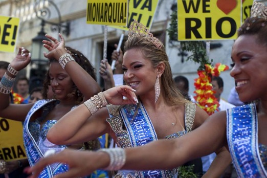 Carnival queen and princesses dance during a ceremony officially opening Carnival season in Rio de Janeiro, Brazil, ...