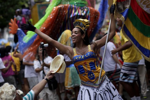 "Revellers participate in the ""Carmelitas"" street carnival parade in Rio de Janeiro, Brazil, Friday, March 4."