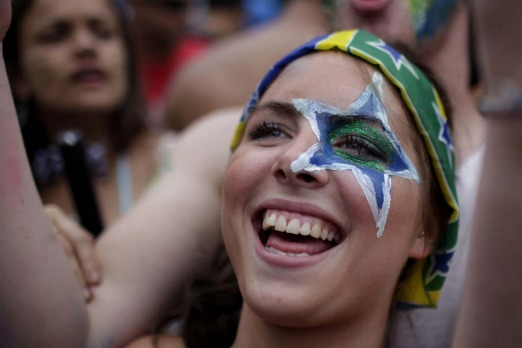 "A reveller laughs during the ""Carmelitas"" street carnival parade in Rio de Janeiro, Brazil, Friday, March 4."