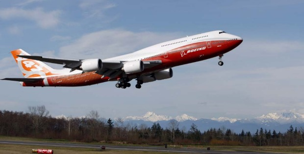 The Boeing 747- 8 Intercontinental passenger plane takes off for its first test flight.