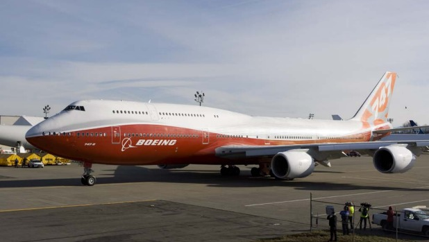 The Boeing 747- 8 Intercontinental passenger plane taxis before taking off on its first test flight at Paine Field in ...