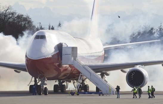 The Boeing 747-8 Intercontinental airliner, the company's newest and largest passenger plane, starts its engines on the ...