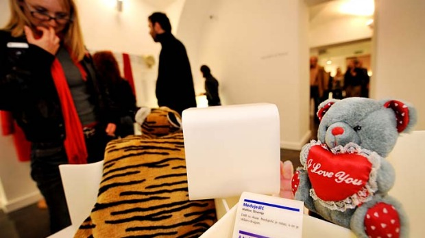Displays of disaffection ... visitors look at the exhibits.