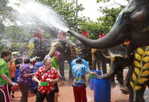 Elephants spray tourists with water during the Songkran water festival in Thailand's Ayutthaya province.