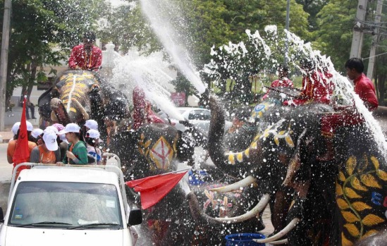 Elephants spray people with water during the Songkran water festival in Thailand's Ayutthaya province, about 80 km north ...